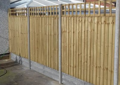 Closeboard panel with 100mm trellis on concrete posts/gboards